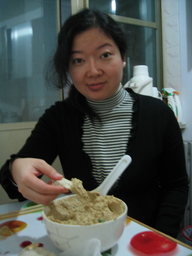 Joyce tries hummus prepared by David